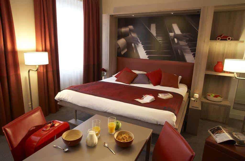 غرفة نوم في شقق أداغيو فيينا سيتي الفندقية